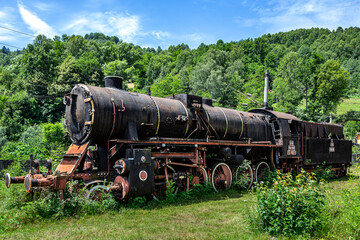 The old steam locomotive is parked in a depot