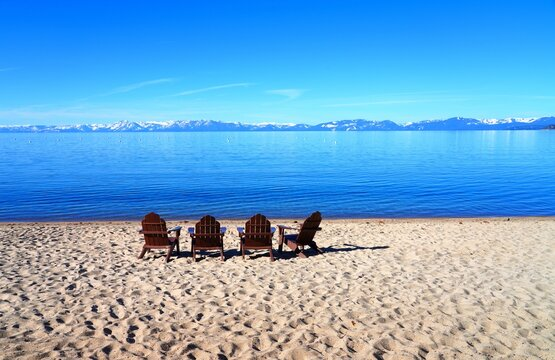 Landscape view of Lake Tahoe with snow-covered mountains and forests seen from Incline Village on the Nevada side