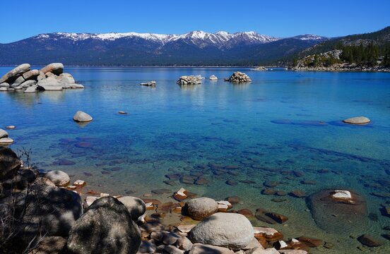 View of rocks and clear blue water in the Lake Tahoe Nevada State Park