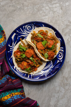Mexican food. Chorizo and nopales tacos on grey background