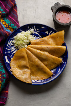 Mexican food. Steamed tacos also called de canasta on grey background