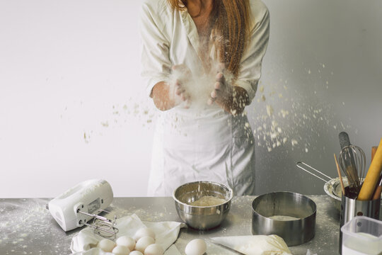 Hands working with dough preparation recipe bread, pizza or pie making ingridients. Cooking cakes.