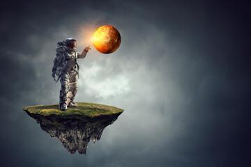 Astronaut walking on an unexplored planet