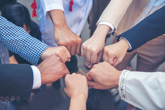 Diverse multiethnic Partners hands together teamwork group of multi racial people meeting join hands togetherness. Diversity people hands join empower partnership teams connection volunteer community