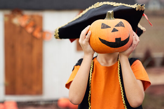 Portrait of boy with pumpkin