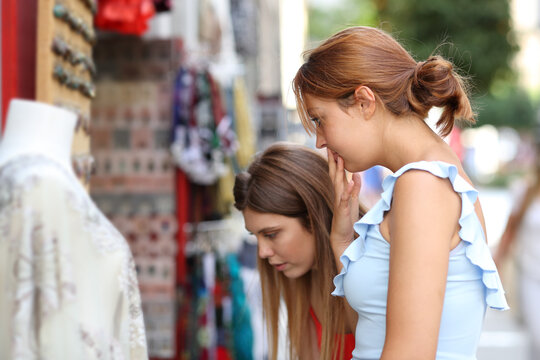 Two women wondering what to buy in a store
