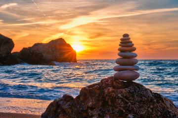 Obraz Concept of balance and harmony - stone stack on the beach - fototapety do salonu