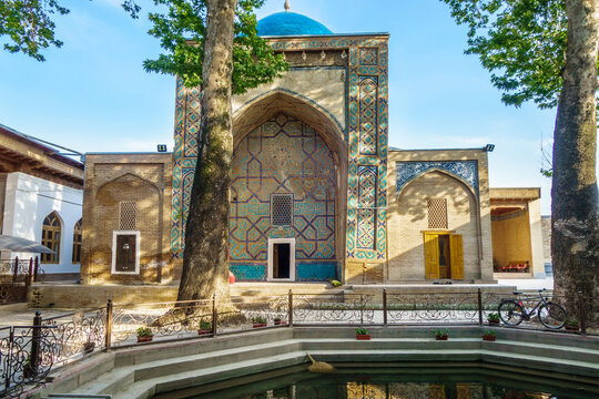 Facade of mausoleum of Khoja Abdi Darun in Samarkand, Uzbekistan. Traditional howz is visible ahead. Building was founded in XII