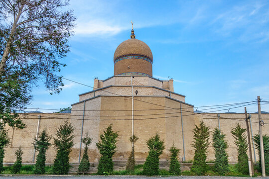 Mosque Namazgoh surrounded by trees, Samarkand, Uzbekistan. Traditional crescent on dome. Built in XVII by benefactor Nadir Divanbegi