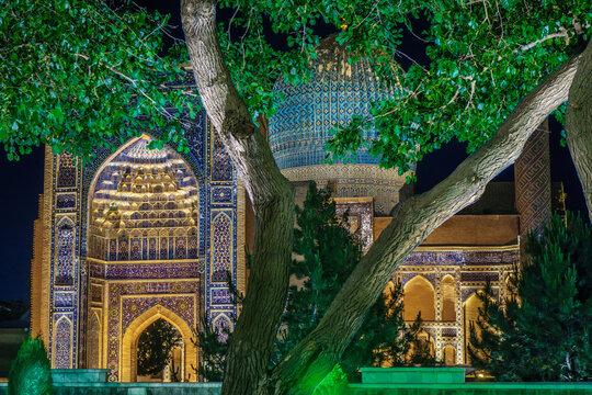 Mausoleum Gur Emir, as it looks at night from the side of the park with illumination, Samarkand, Uzbekistan