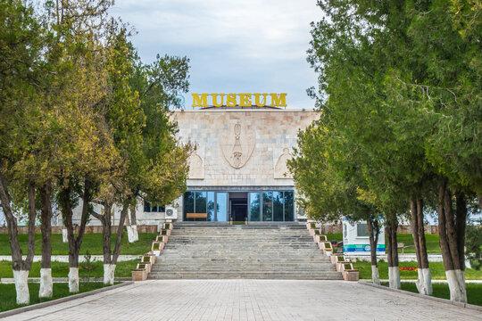 Facade of Afrasiab museum in Samarkand, Uzbekistan. Inscription above doorway translates as 'Museum of History of Samarkand'