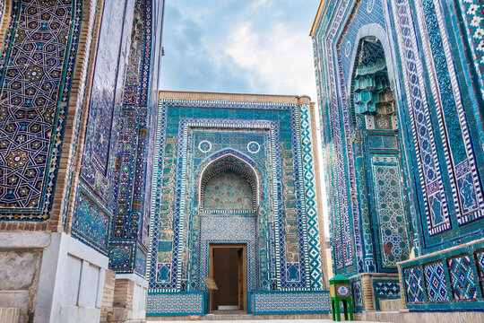 Facades of mausoleums of the Shah-i-Zinda complex, Samarkand, Uzbekistan. From left to right: Tuman-aga, Khojda Ahmad, Nameless. Included in UNESCO. Inscription on green box: 'donation box'