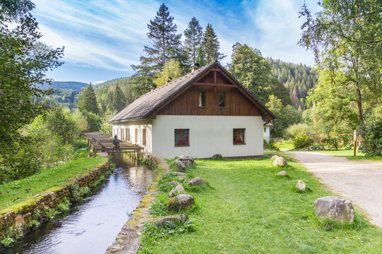 Traditional cottage in the landscape of the Sumava mountains, Czech Republic