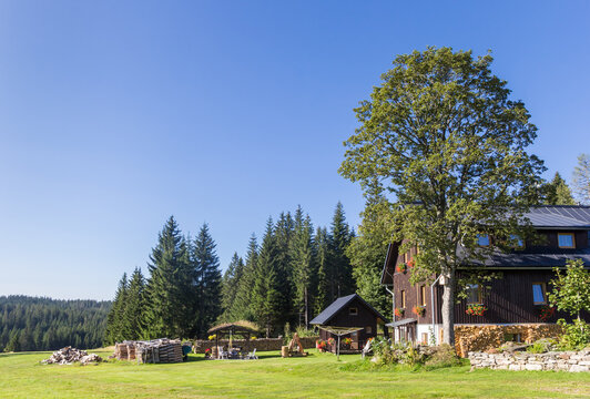 Traditional wooden house in the landscape of the Sumava mountains national park, Czech Republic