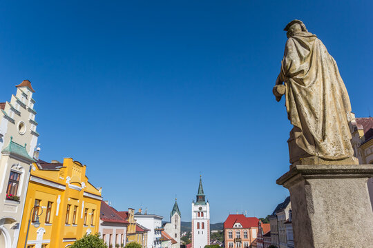 Statue and colorful buildings in the town center of Vimperk, Czech Republic