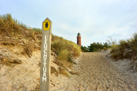Protected aera sign of the natural reserve Fischland Darss with Light tower and sand dunes