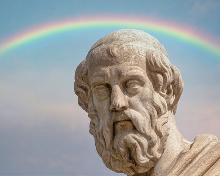 Plato, the ancient Greek philosopher statue and a rainbow in the sky, Athens Greece