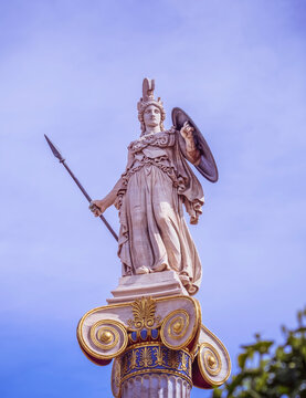Athena marble statue the ancient goddess of wisdom and knowledge on Ionian order column, Athens Greece