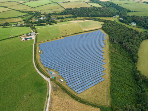 Aerial shot of Solar Panel Photovoltaic farm in UK countryside