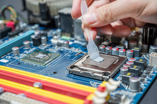close-up Thermal compound on cpu chip in mainboard computer