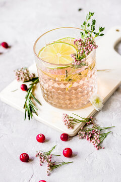 fresh homemade drink with berries and lime on kitchen background