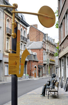 Dinant, Belgium  sculpture of the saxophone inventor Adolphe Sax in the street with contrabass sax sign