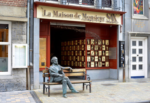 Dinant, Belgium, sculpture of Adolphe Sax on a bench in front of the Museum