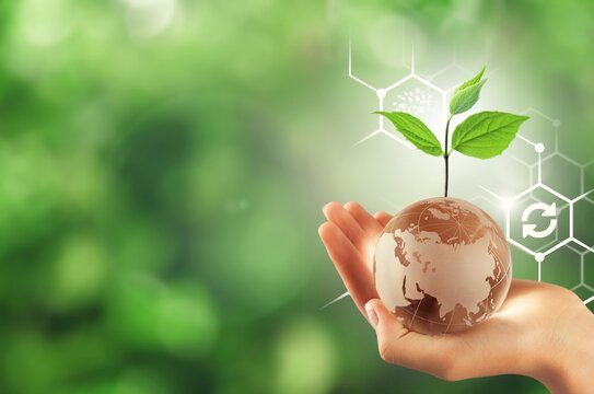 Renewable energy concept, Hand with the globe, save the planet.