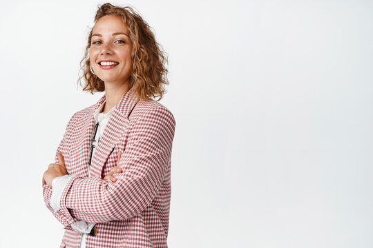 Hopeful young manager, businesswoman cross arms on chest, smiling and looking confident like real professional, white background