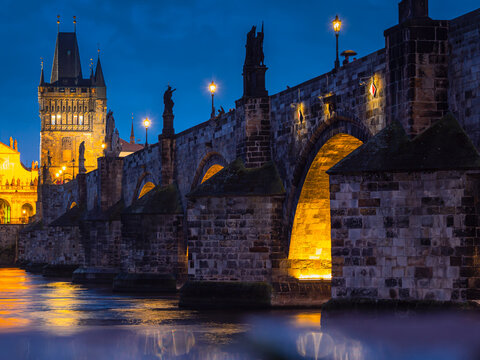 View of Charles Bridge in Prague in the night, Czech Republic. popular tourist attraction. Travel and sights of city breaks. landmarks, travel guide and postcard.