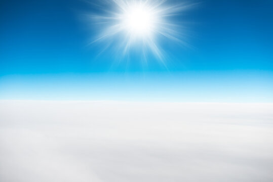 Sun and white clouds on blue clear sky for nature background