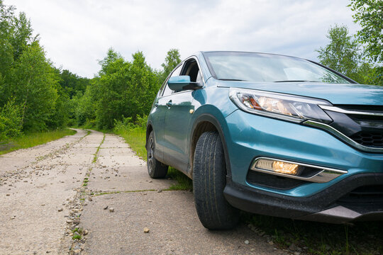 likitsary, transcarpathia, ukraine - JUL 02, 2020: suv on the side of concrete road through forest. travel your back country concept