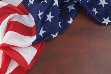 Obraz USA flag on wooden background. Close up of waved United States flag wit copy space for text. - fototapety do salonu