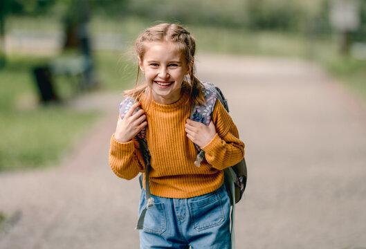 Schoolgirl with backpack outdoors