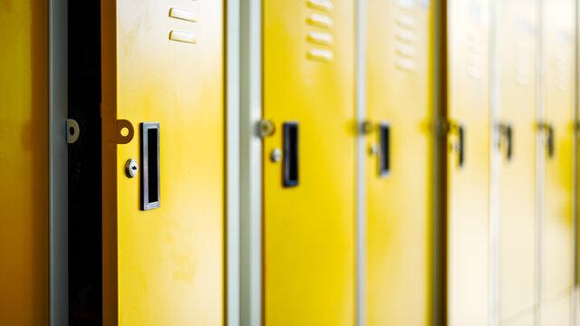 Row of yellow metal lockers in locker room