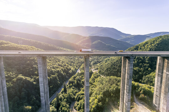 delivery truck drive on highway viaduct aerial view