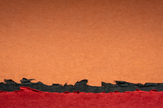 abstract landscape in red, black and orange - a collection of colorful handmade Indian papers produced from recycled cotton fabric