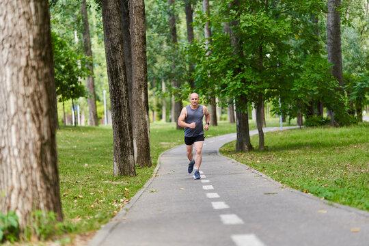 Marathon runner training in the park