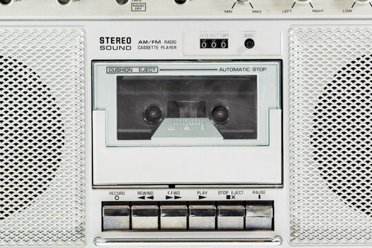 Macro detail of vintage stereo boom box cassette player.