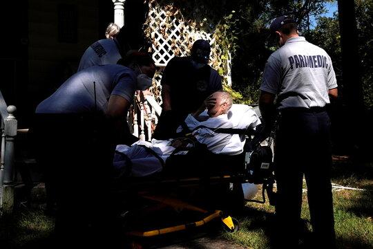 Paramedics prepare to transport a potential coronavirus disease patient in McLoud