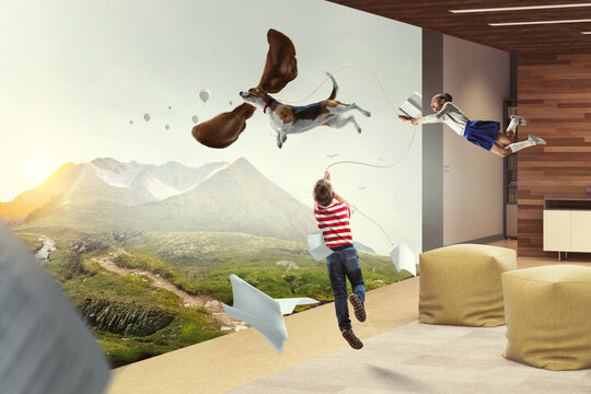 Boy with a dog flying through the air with his ears