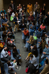 Conference audience watching speakers on stage