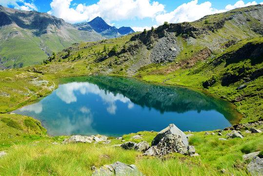 Mountain lake Lago di Loie in National park Gran Paradiso, Lillaz, Cogne, Aosta valley, Italy. Summer landscape in the Alps.