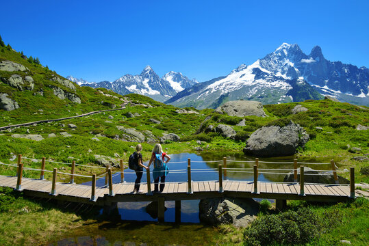 Idyllic landscape with Mont Blanc mountain range in sunny day. Hikers on trip in the Nature Reserve Aiguilles Rouges, French Alps, France, Europe.