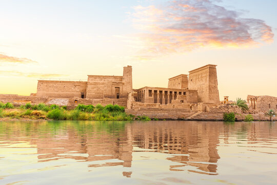 Temple of Isis on Philae Island at sunset, view from the Nile, Aswan, Egypt
