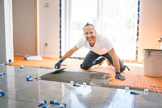 nice handyman install tile on the floor