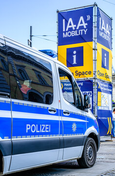Munich, Germany - September 9: sign of the IAA (Internationale Auto Ausstellung - translation: international auto exhibition) trade fair and a police car in Munich on September 9, 2021