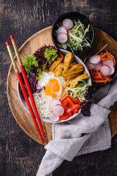 Korean Bibimbap. Bowl with meat, rice and salad