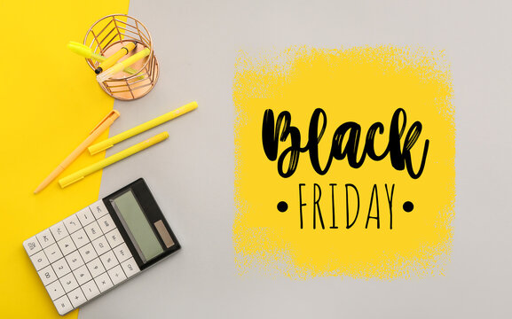 Calculator with stationery and text BLACK FRIDAY on color background