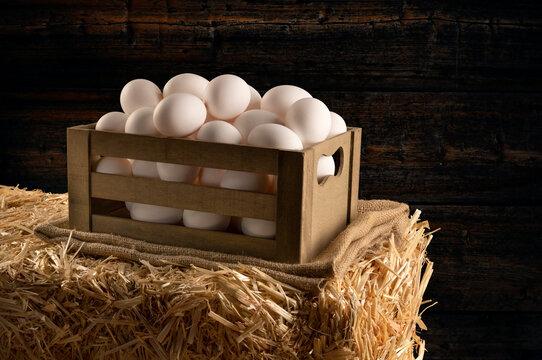 Crate of fresh eggs in barn